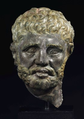 A GREEK PARCEL GILT SILVER HEAD OF A BEARDED MAN