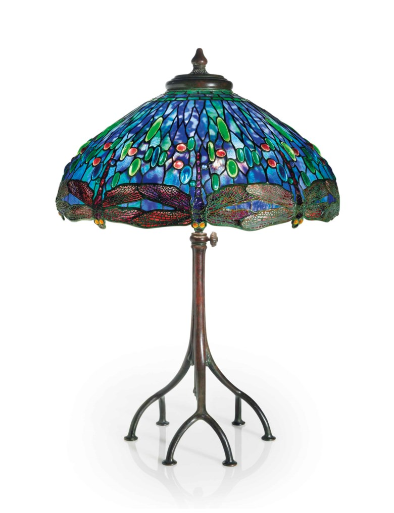 Tiffany Studios, A Drophead dragonfly leaded glass and bronze table lamp, circa 1905. 32  in (81.3  cm) high, 22⅛  in (56.2  cm) diameter of shade. This lot was offered in the Design sale on 14 December 2017  at Christie's in New York and sold for $492,500