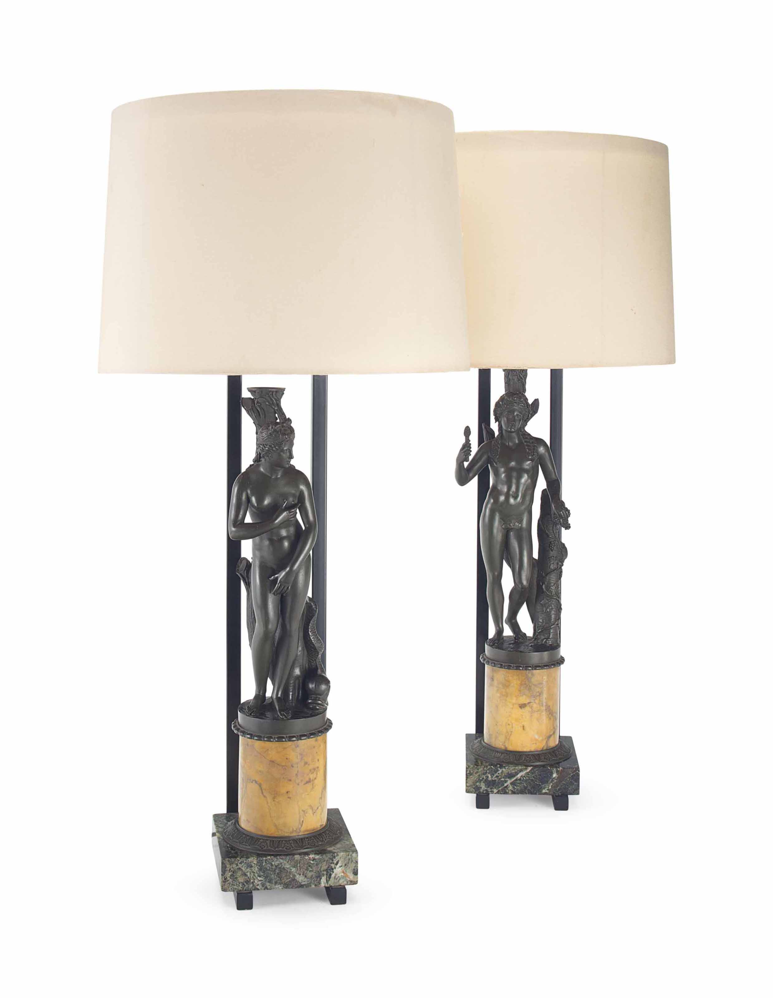 A PAIR OF FRENCH BRONZE AND MARBLE TABLE LAMPS