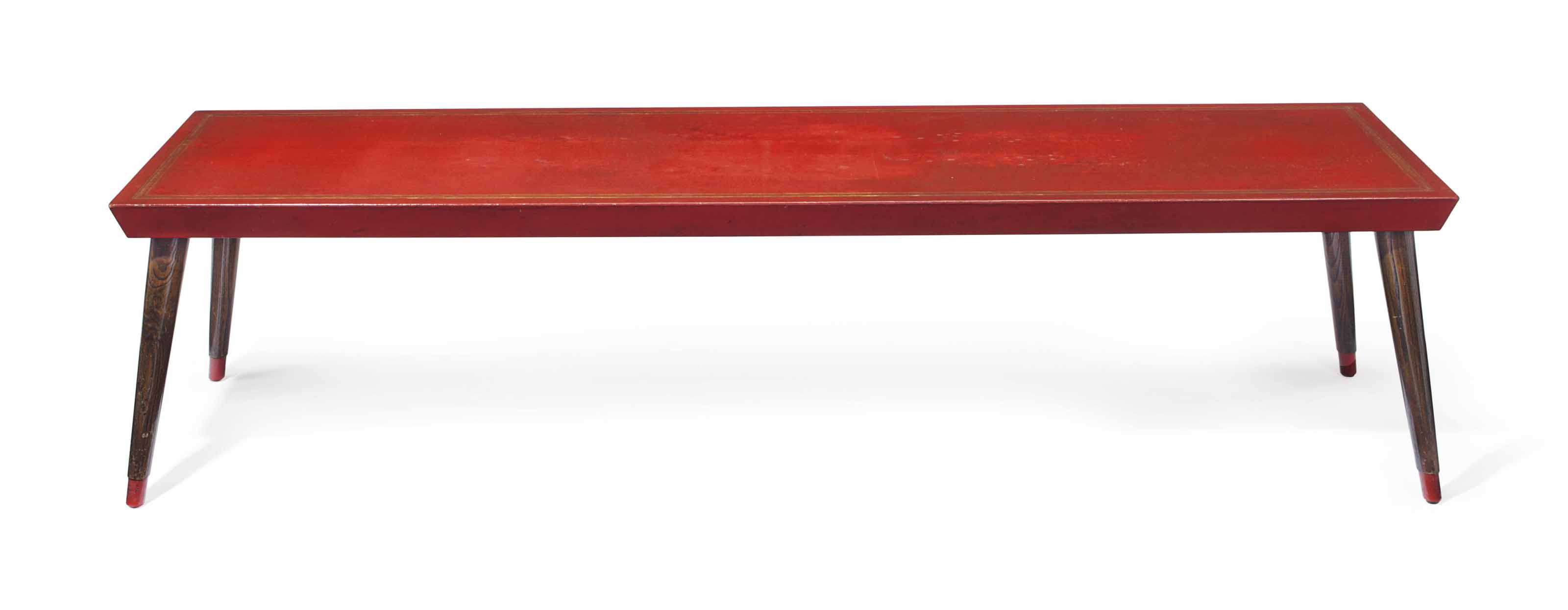 A RED LEATHER AND ELM LOW TABLE
