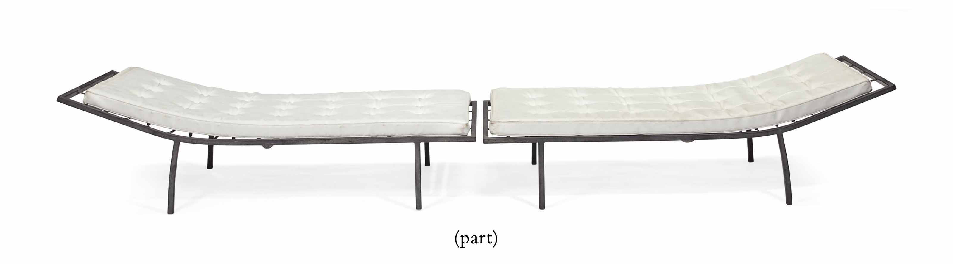 A PAIR OF BLACK-PAINTED METAL CHAISE LONGUES