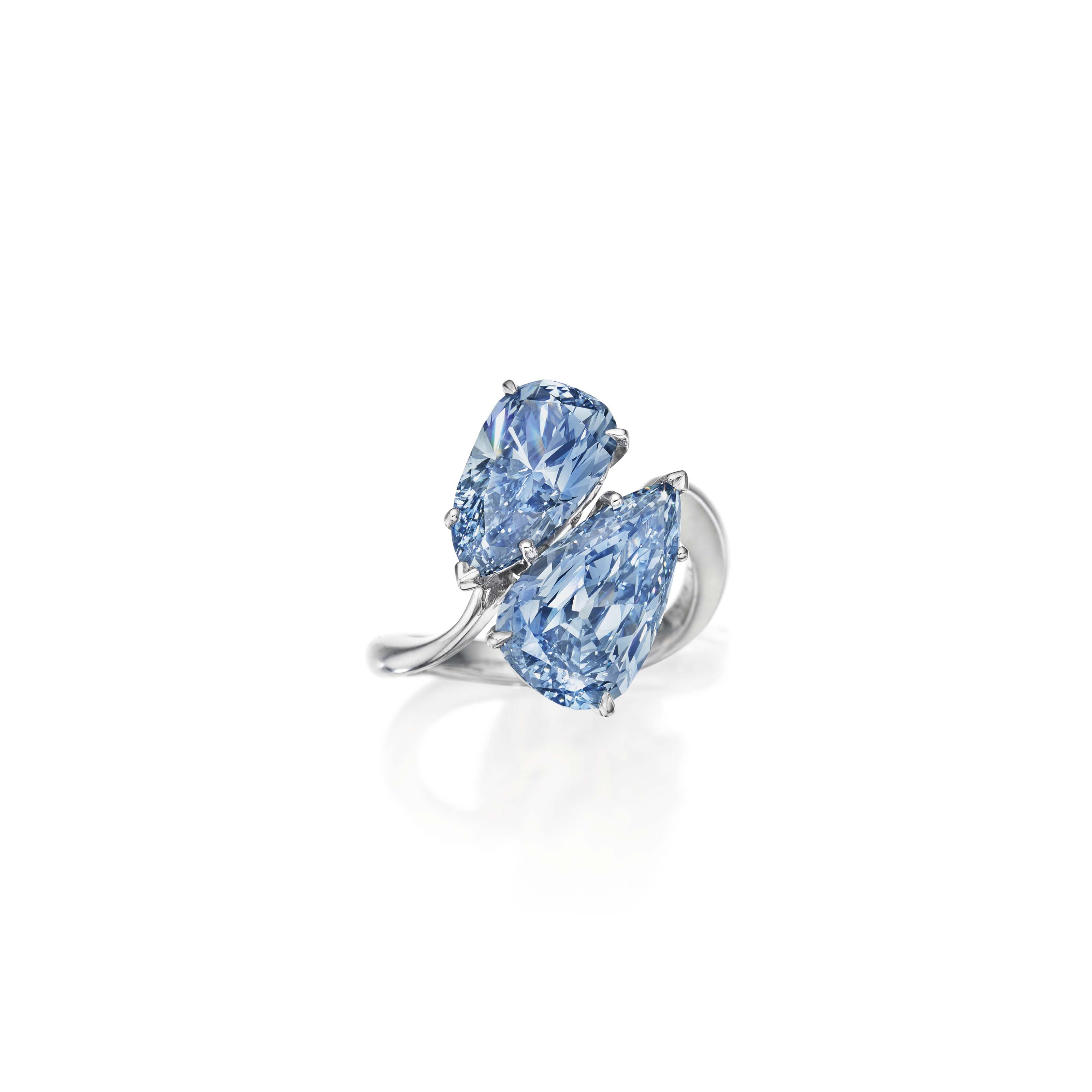 A SUPERB TWIN-STONE COLORED DIAMOND RING, BY GRAFF