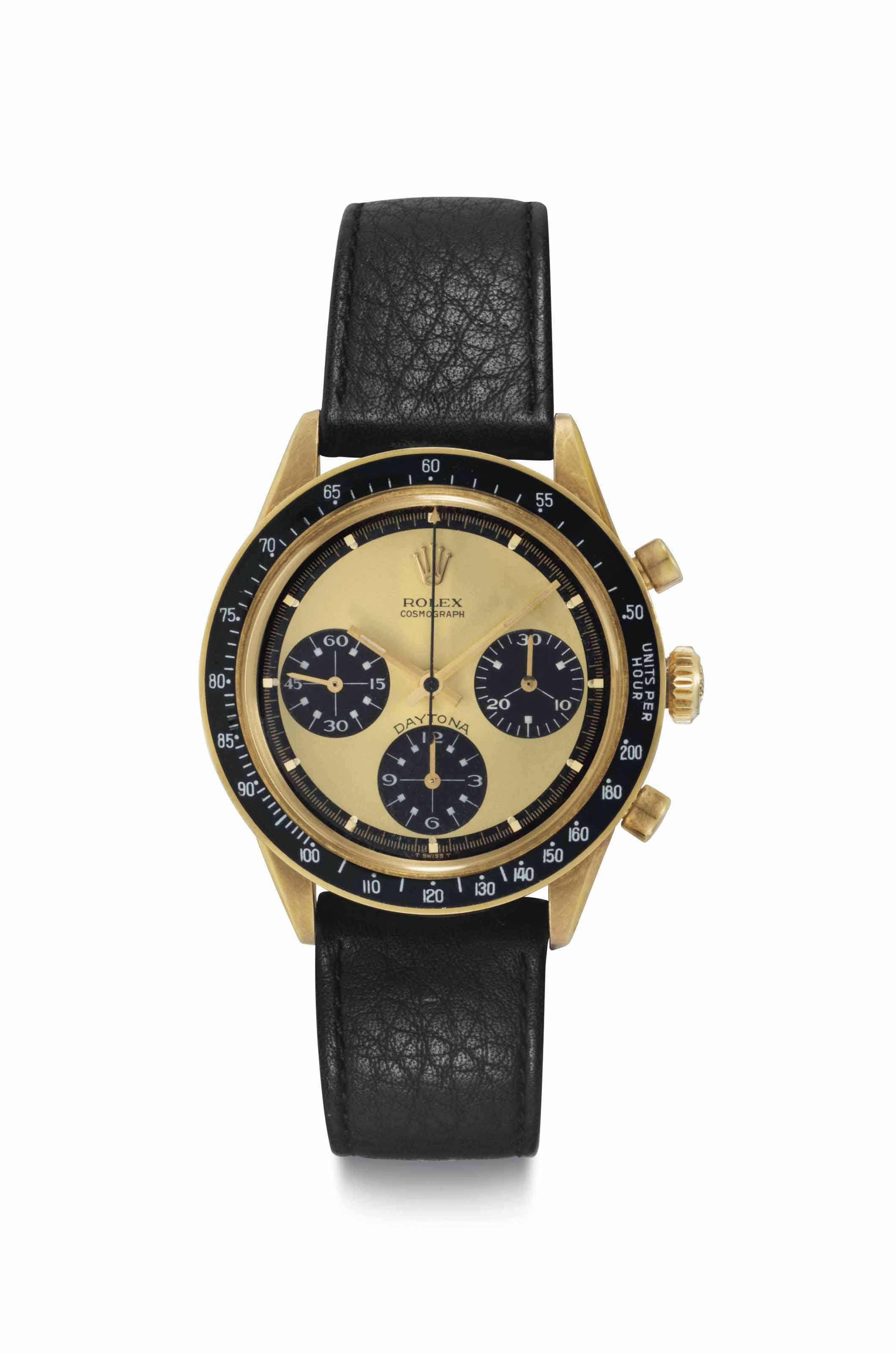 "Rolex. An Extremely Rare, Fine, and Attractive 18k Gold Chronograph Wristwatch with Lemon ""Paul Newman"" Dial and White Numerals to the Subsidiary Dials"