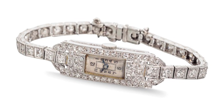 Gruen. A ladies fine platinum and diamond-set bracelet watch, formerly belonging to American jazz musician and singer-songwriter Billie Holiday. Signed Gruen, circa 1938. Case platinum, diamond-set bezel and lugs, engraved band, engraved snap on back reading, To Billie From David, 1938, 11mm width, 34mm overall length. Estimate $12,000-18,000. This lot is offered in An Evening of Exceptional