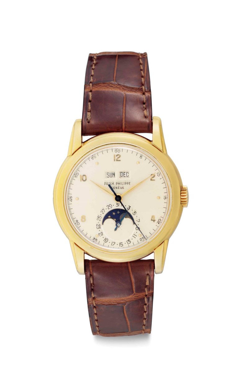 Patek Philippe. A Very Fine and Extremely Rare 18k Gold Perpetual Calendar Wristwatch with Moon Phases and Center Seconds, Signed patek philippe, genève, retailed by gubelin, ref. 2497, movement no. 888002, case no. 674367, manufactured in 1951, accompanied by an associated 18k gold monogrammed bracelet, a patek philippe extract from the archives confirming date of sale on august 17,1953, a patek