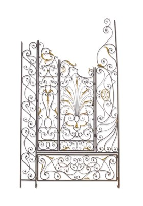 A PAIR OF WROUGHT-IRON AND PARCEL-GILT SCREEN PANELS