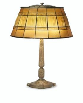 AN AMERICAN GILT-BRONZE LAMP BASE AND A 'LINENFOLD' SHADE