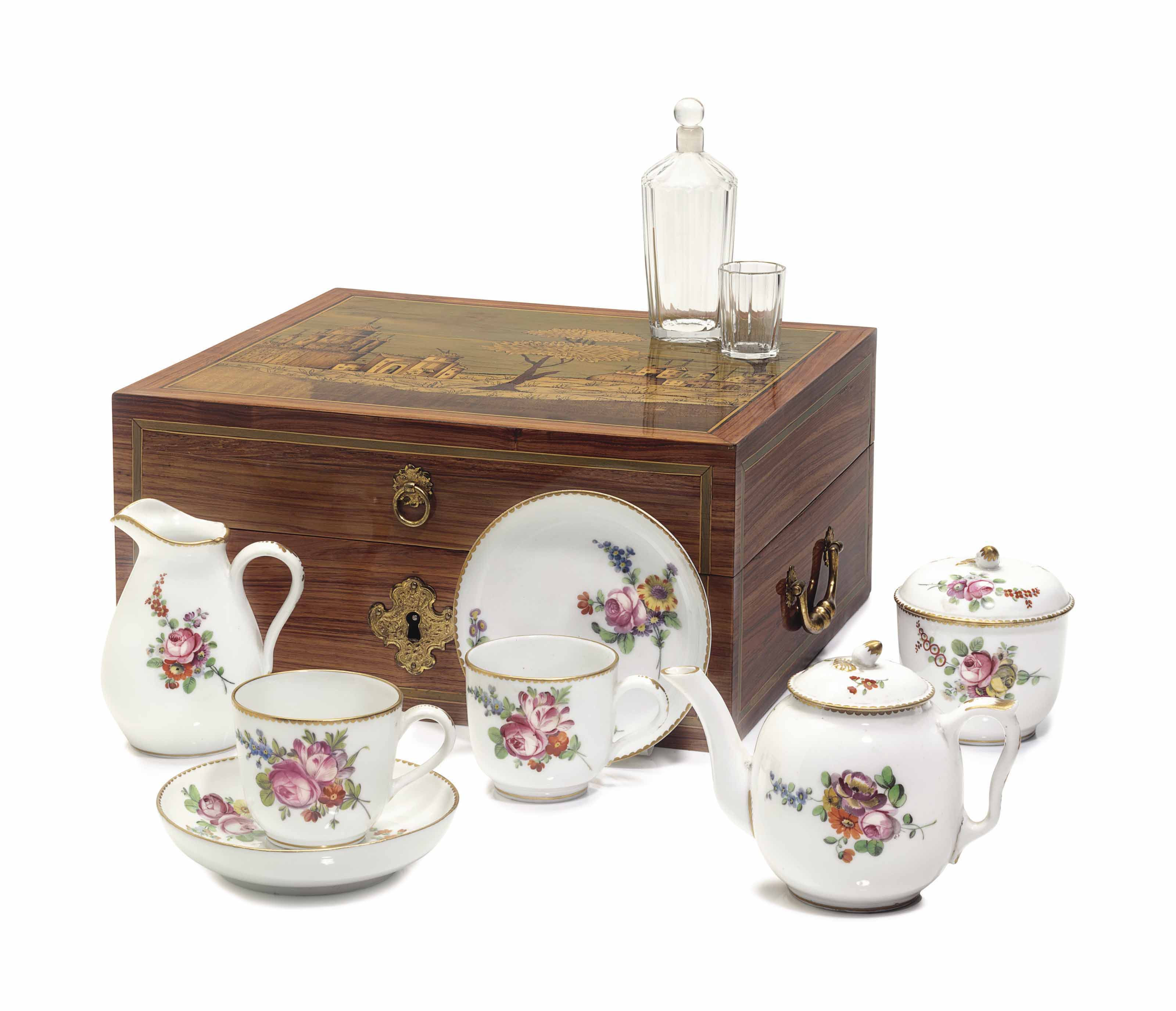 A LOCRE PORCELAIN, SILVER AND GLASS TRAVELING SERVICE IN A LOUIS XVI TULIPWOOD MARQUETRY BOX
