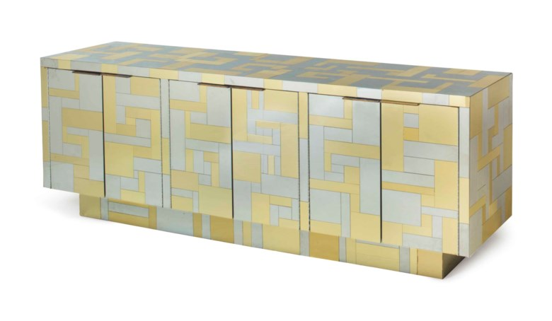 Paul Evans (1931-1987), A 'Cityscape' sideboard, circa 1970. 32  in (81.2  cm) high, 90¼  in (229.2  cm) wide, 22  in (55.9  cm) deep. Estimate $6,000-9,000. This lot is offered in Interiors on 12-13 December 2017  at Christie's in New York