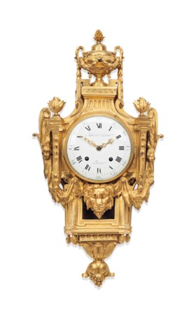 A LATE LOUIS XV ORMOLU CARTEL CLOCK