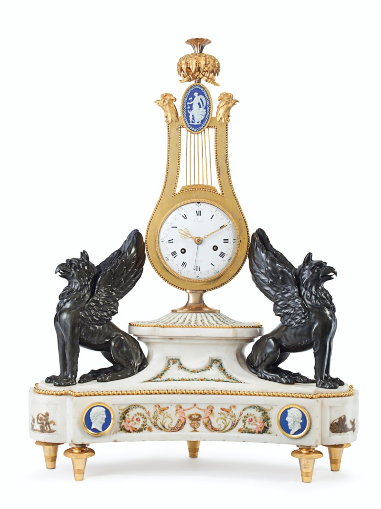 A Louis XVI ormolu, patinated bronze, polychrome-painted and white marble clock, circa 1785. 28½  in (72  cm) high, 21½  in (54.5  cm) wide, 7½  in (19  cm) deep. Estimate $70,000-100,000. This lot is offered in French & English Furniture from a Distinguished Private Collection  on 24 October 2017  at Christie's in New York