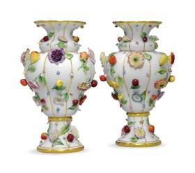 A PAIR OF MEISSEN PORCELAIN FRUIT AND FLOWER ENCRUSTED VASES
