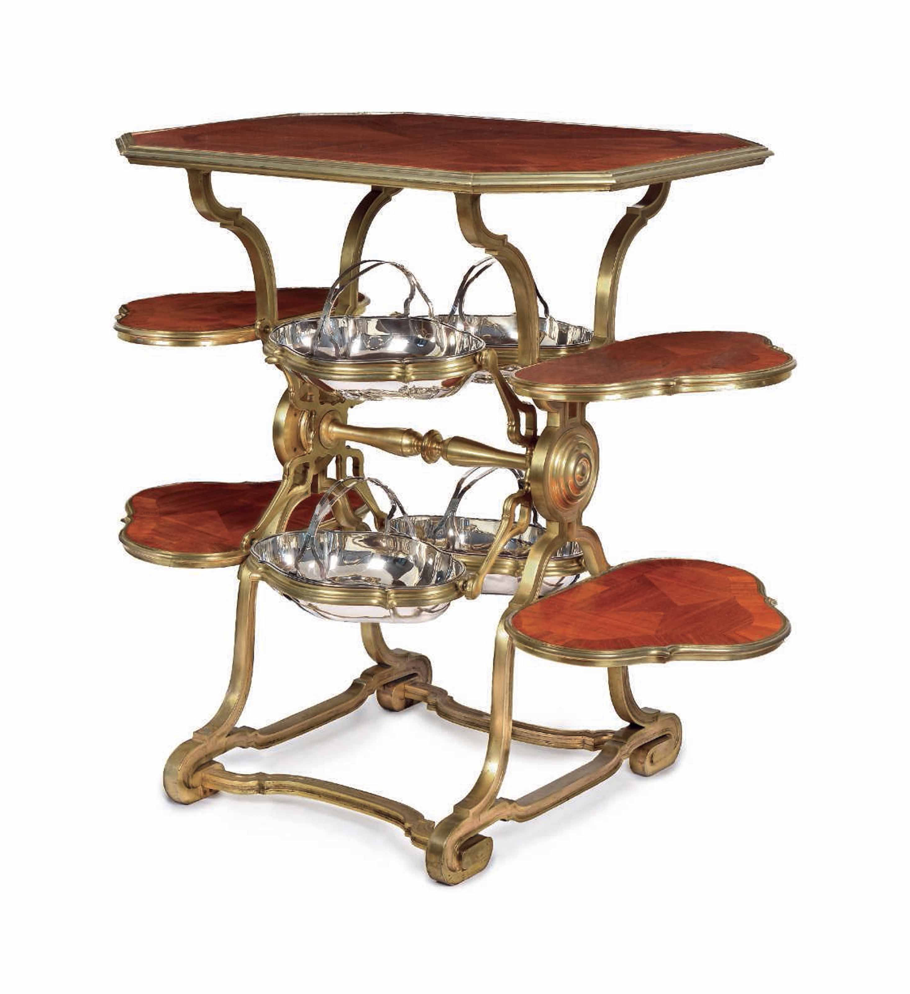 AN UNUSUAL FRENCH ORMOLU AND SILVER-MOUNTED MAHOGANY 'FERRIS WHEEL' SERVING-TABLE