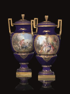 TWO ORMOLU-MOUNTED SEVRES PORCELAIN COBALT-BLUE GROUND VASES AND COVERS (VASE FE