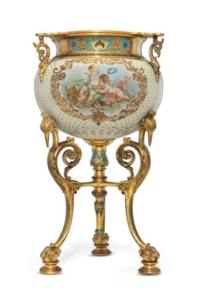 AN ORMOLU AND CHAMPLEVE MOUNTED SEVRES STYLE PORCELAIN BOWL