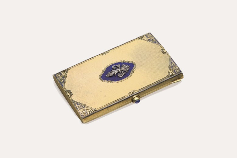 An 18k gold, silver and diamond case, mark of Cartier, Paris, first half 20th century. 3  in (7.6  cm) long. This lot was offered in THE COLLECTOR 19th Century Furniture, Sculpture, Works of Art, Ceramics & Silver on 17 October 2017  at Christie's in New York