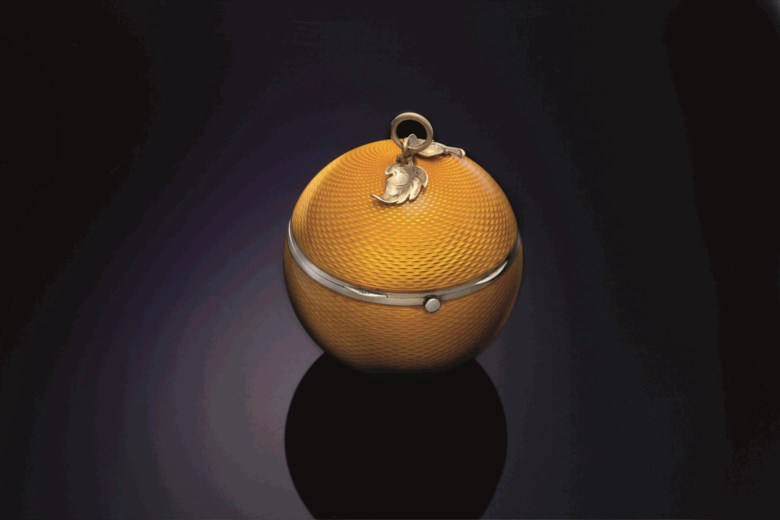 A silver and enamel fruit-form pomander, Mark of Van Cleef and Arpels, Paris, second quarter 20th century. 2⅝  in (6.7  cm) diameter. This lots was offered in THE COLLECTOR 19th Century Furniture, Sculpture, Works of Art, Ceramics & Silver on 17 October 2017  at Christie's in New York