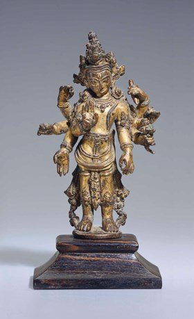 A gilt bronze figure of Amoghapasha