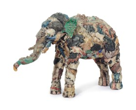 AN INDIAN POLYCHROME-PAINTED COMPOSITE FIGURE OF AN ELEPHANT