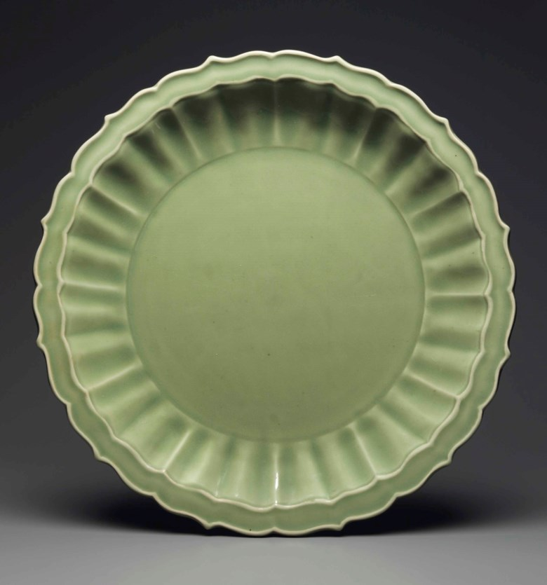 A superb large Longquan celadon bracket-lobed dish, early Ming dynasty, late 14th-early 15th century. 19 in (48.2 cm) high. Estimate $300,000-400,000. This lot is offered in Marchant Nine Decades in Chinese Art on 14 September 2017 at Christie's in New York