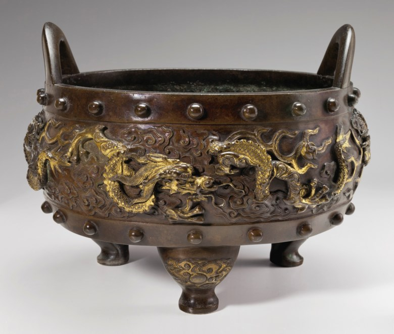 An exceptional large parcel-gilt-bronze tripod censer, Xuande Yuannian mark corresponding to 1426, Ming Dynasty, 15th-17th century. 12 in. (30.5 cm.) diam. Estimate $70,000-90,000. This lot is offered in Marchant Nine Decades in Chinese Art on 14 September 2017 at Christie's in New York