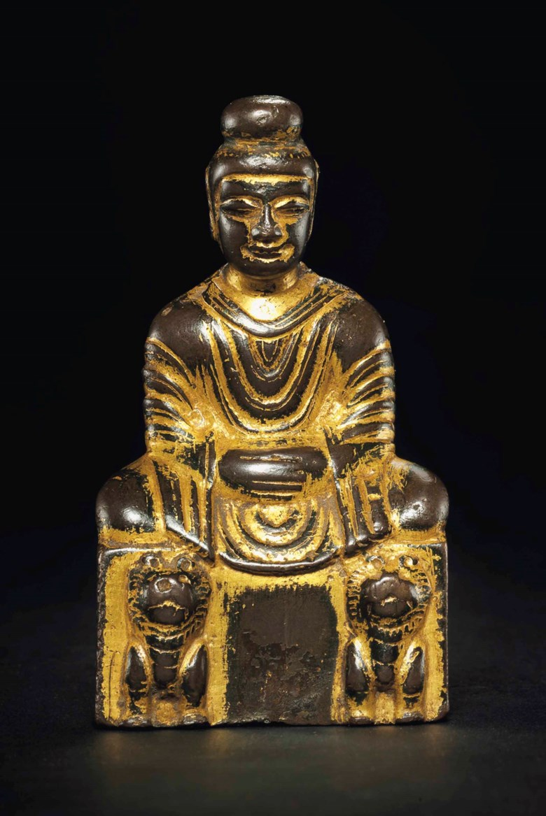 A small gilt-bronze figure of Shakyamuni Buddha. Sixteen Kingdoms period (AD 304-439). 3½ in (9 cm) high. Estimate $30,000-40,000. This lot is offered in Treasures of the Noble Path Early Buddhist Art from Japanese Collections on 14 September 2017 at Christie's in New York