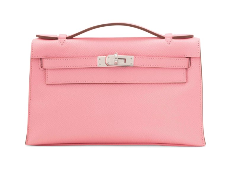 Kelly Pochette in Rose Confetti, Hermès, 2016. 22 x 13 x 6  cm. Estimate €3,000-4,000. This lot is offered in Sacs & Accessoires on 12 December 2017  at Christie's in Paris