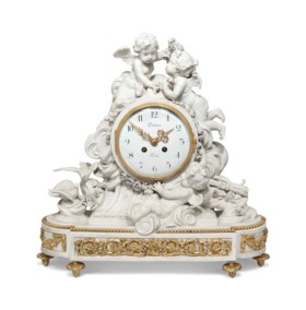 A FRENCH ORMOLU-MOUNTED BISCUIT PORCELAIN MANTEL CLOCK