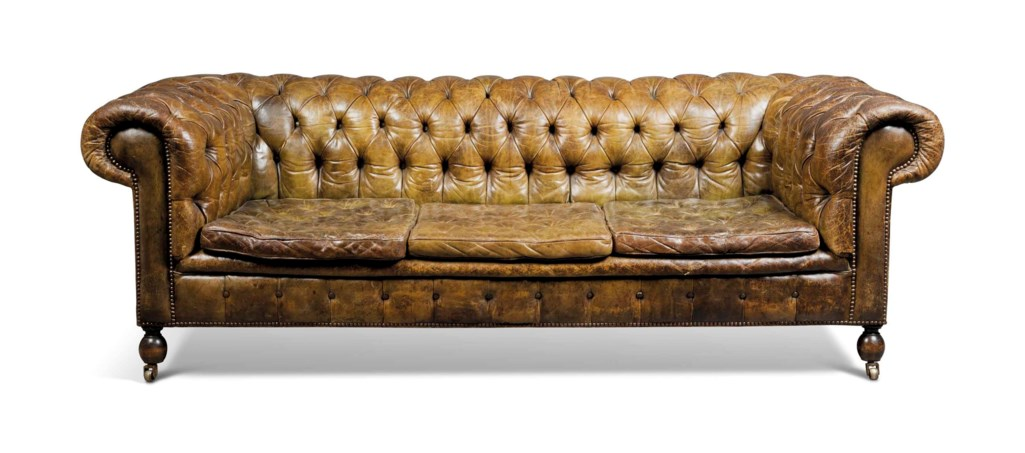 AN ENGLISH BROWN BUTTONED-LEATHER CHESTERFIELD THREE-SEAT SOFA