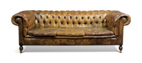 AN ENGLISH BROWN BUTTONED-LEATHER CHESTERFIELD THREE-SEAT SO