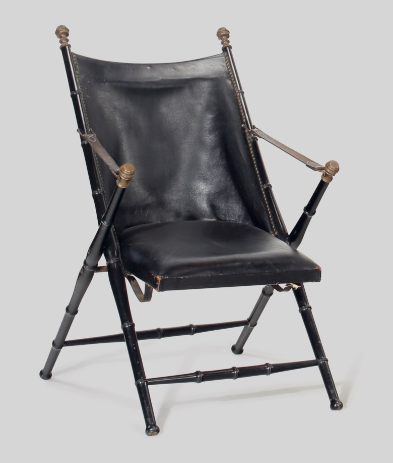 A leather and ebonised folding Campaign chair, second half 20th century, possibly Maison Jansen. 36  in (91.4  cm) high. Estimate $1,000-1,500. This lot is offered in the JF Chen Collection on 13 February 2018  at Christie's in New York