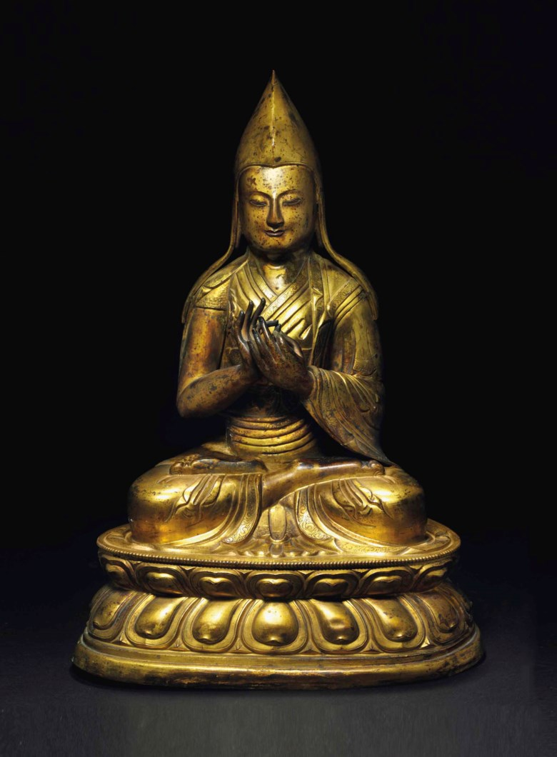 A tibeto-chinese gilt-copper repousse figure of a seated lama, 18th century. 17 ¾  in (45  cm) high. Estimate $20,000-30,000. This lot is offered in JF Chen Collection on 13 February 2018  at Christie's in New York