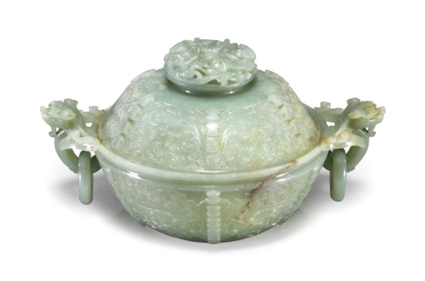 A CHINESE CARVED PALE GREENISH