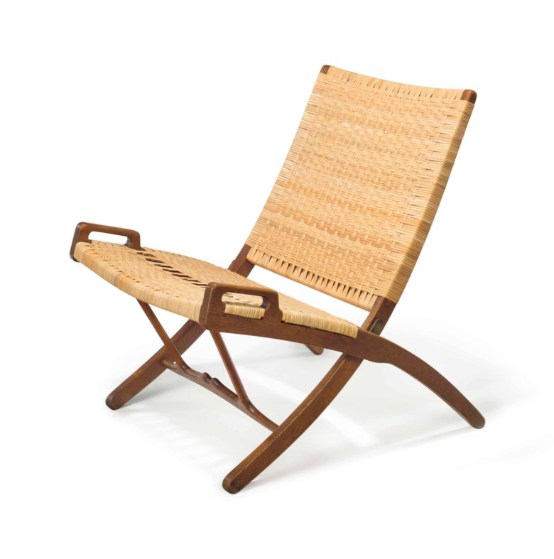 Hans Wegner (1914-2007), a folding chair, model JH512, designed 1949. 29¾  in (75.5  cm) high. Estimate $3,000-5,000. This lot is offered in the JF Chen Collection on 13 February 2018  at Christie's in New York