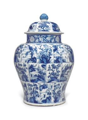 A VERY LARGE BLUE AND WHITE JAR AND COVER
