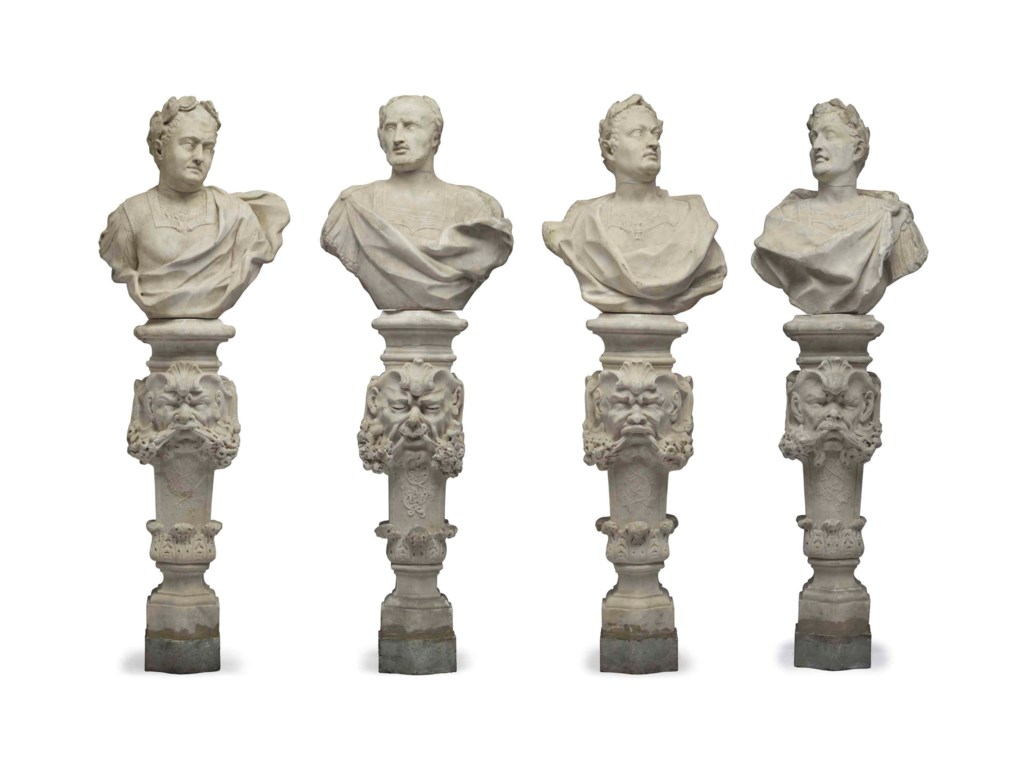 A SET OF FOUR WHITE MARBLE BUSTS OF ROMAN EMPERORS ON PEDESTALS