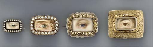 A group of four left eyes; three with blue iris and one with brown.
