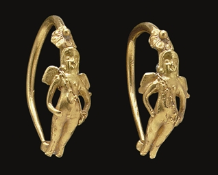 the historical and cultural significance of greek earrings with heads of lynxes and mesopotamian ear