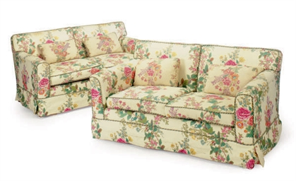 A Pair Of Ivory Ground And Floral Chintz Upholstered Two