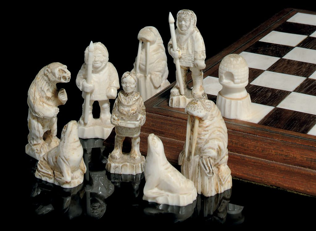 An arctic circle carved walrus ivory figural chess set and