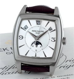 PATEK PHILIPPE A FINE 18K WHITE GOLD AUTOMATIC ANNUAL CALENDAR WRISTWATCH WITH CENTER SECONDS