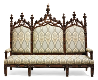 A Gothic Revival Carved Oak Triple Back Hall Settee