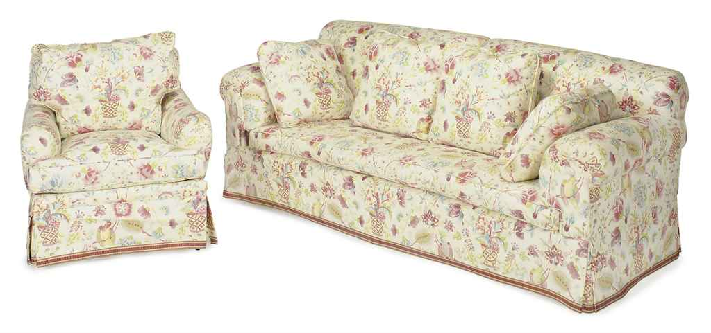 A three piece cream ground floral chintz upholstered for Chintz couch
