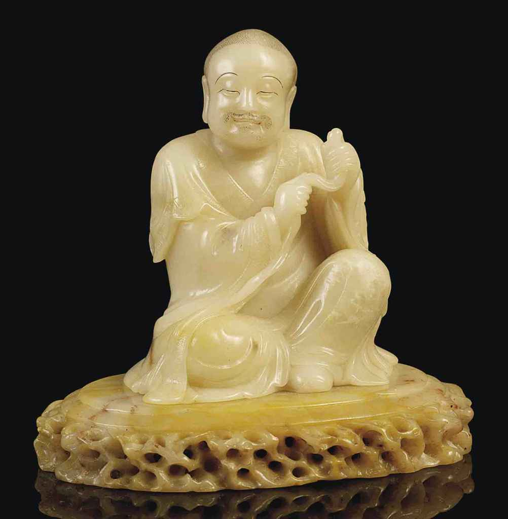 What Is History Soapstone: A FINE CARVED SOAPSTONE FIGURE OF A LUOHAN , 18TH CENTURY