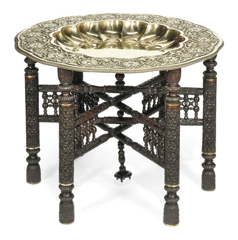 Indian Glass Top Coffee Table: AN INDIAN EMBOSSED BRASS COFFEE TABLE , CIRCA 1930