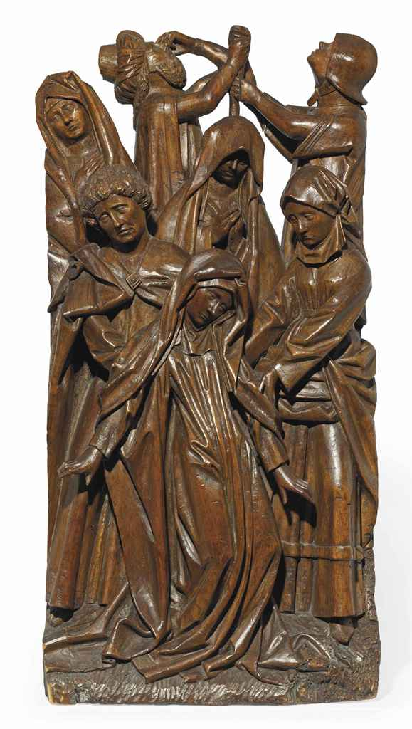 A carved oak relief of the swooning virgin