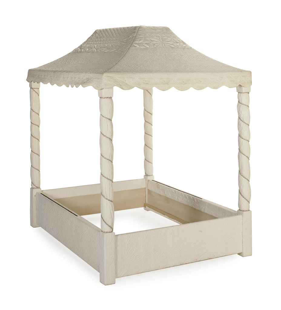 A quilted white cotton covered queen size canopy bed for White canopy queen bed