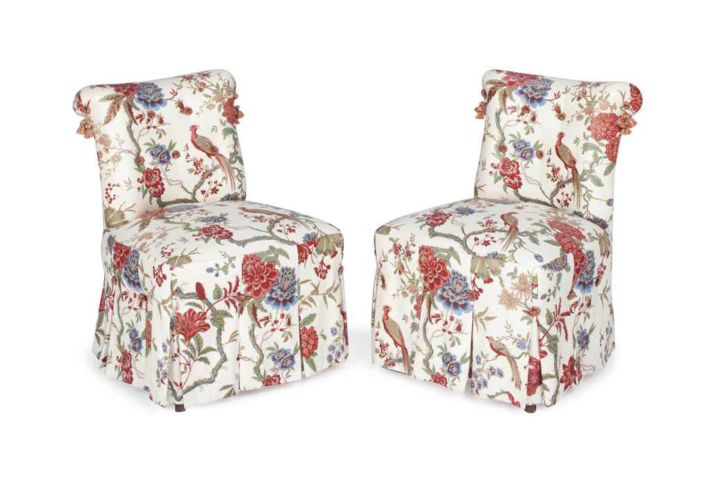 A pair of cream ground floral chintz upholstered slipper for Chintz couch