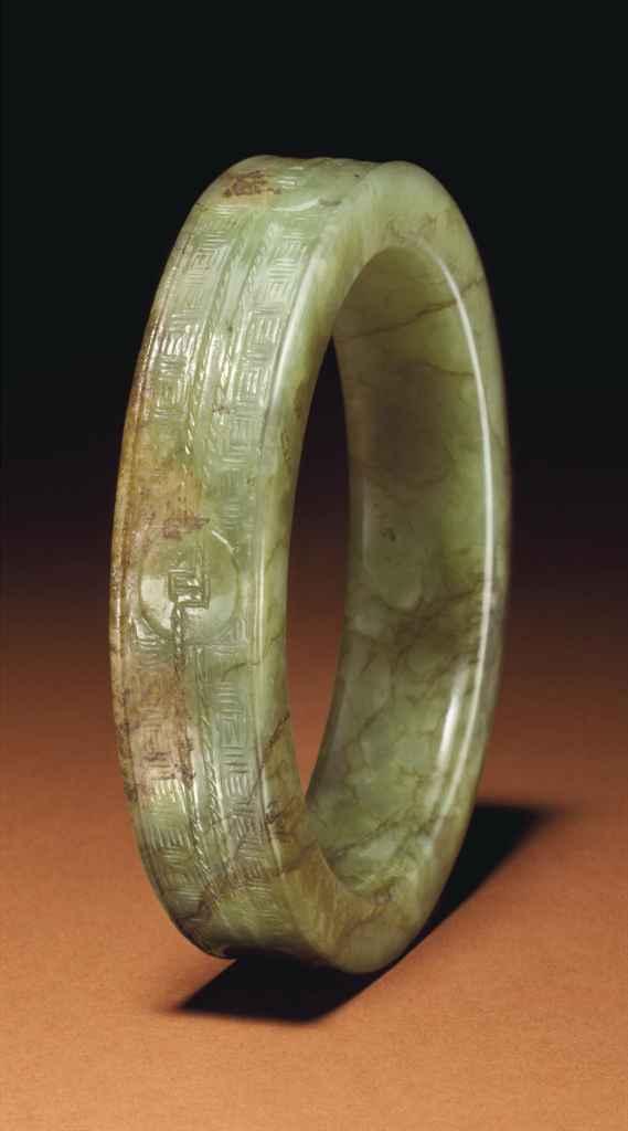 A greenish yellow and brown jade bangle ming dynasty