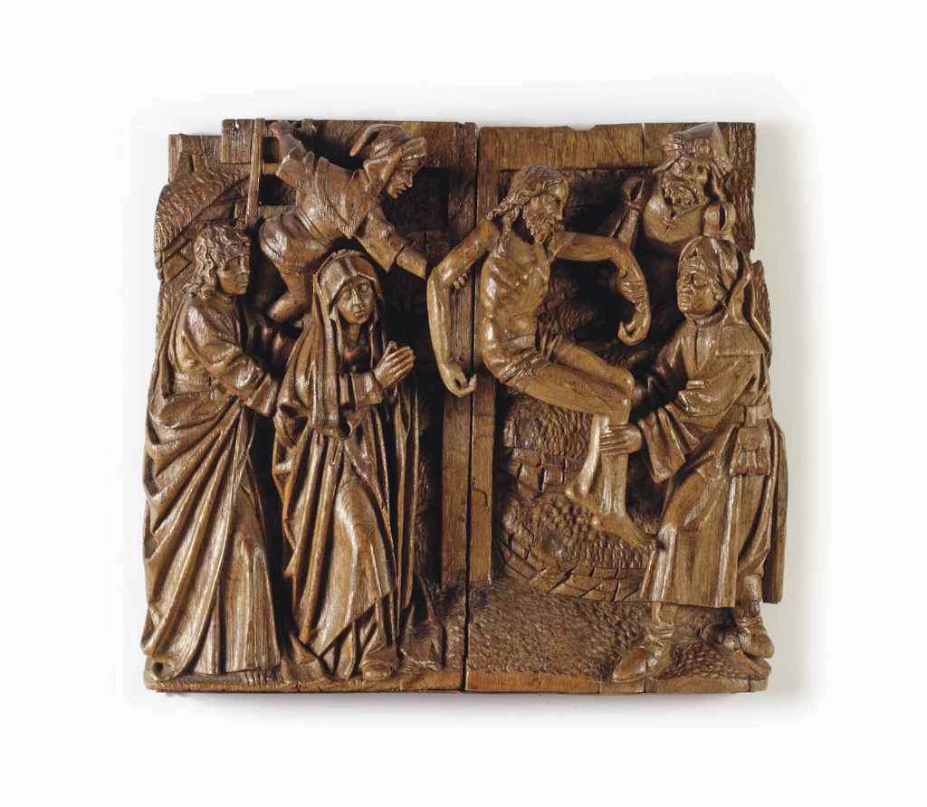 A carved oak relief depicting the descent from cross